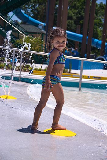 Young girl playing at the waterpark